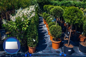 shrubs and trees at a nursery - with North Dakota icon